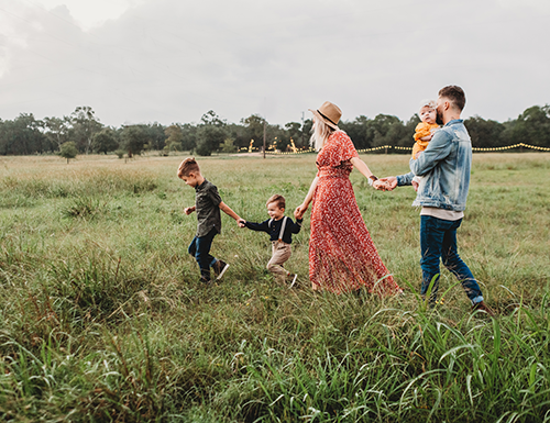 family playing a field